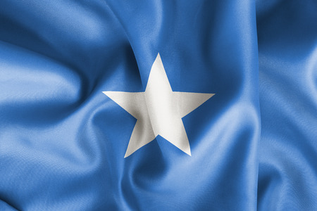 creased: Somalia flag texture creased and crumpled up with light and shadows