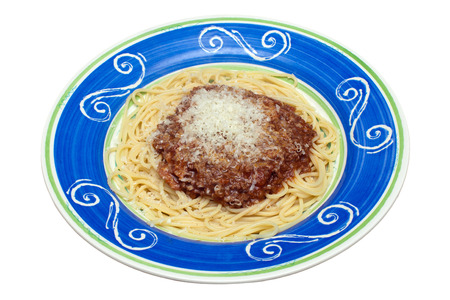 spaghetti bolognese: Spaghetti Bolognese in a colourful hand painted dish on an isolated white background