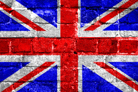 urban decay: United Kingdom union jack flag with a worn brick wall texture Stock Photo
