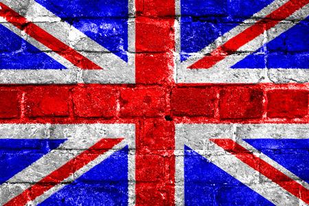 grunge union jack: United Kingdom union jack flag with a worn brick wall texture Stock Photo