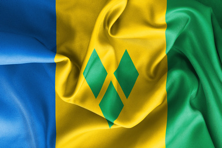 creased: Saint Vincent and the Grenadines flag texture creased and crumpled up with light and shadows