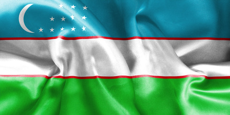 creased: Uzbekistan flag texture creased and crumpled up with light and shadows