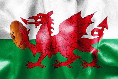 welsh: Welsh flag texture with a dragon holding a rugby ball Stock Photo