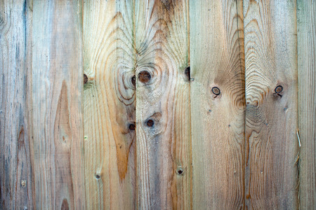 untreated: Fence panel close-up with vertical panels that are weathered and untreated with any varnish or paint Stock Photo