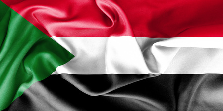 creased: Sudan flag texture creased and crumpled up with light and shadows