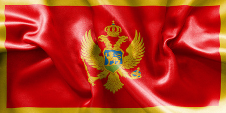 scrunch: Montenegro flag texture creased and crumpled up with light and shadows Stock Photo