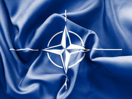 nato: NATO flag texture creased and crumpled up with light and shadows Stock Photo