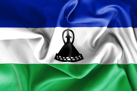 scrunch: Lesotho flag texture creased and crumpled up with light and shadows Stock Photo