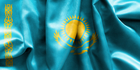 creased: Kazakhstan flag texture creased and crumpled up with light and shadows