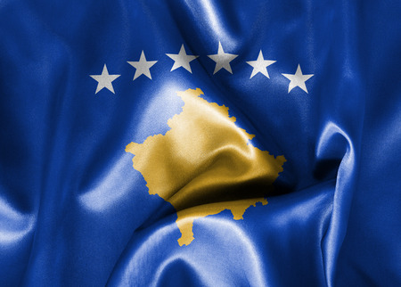 scrunch: Kosovo flag texture creased and crumpled up with light and shadows