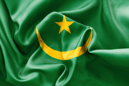 scrunch: Mauritania flag texture creased and crumpled up with light and shadows