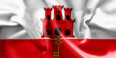 creased: Gibraltar flag texture creased and crumpled up with light and shadows