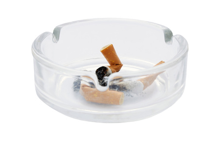 burnt out: Ash tray with burnt out cigarette butts on an isolated white background with a clipping path Stock Photo