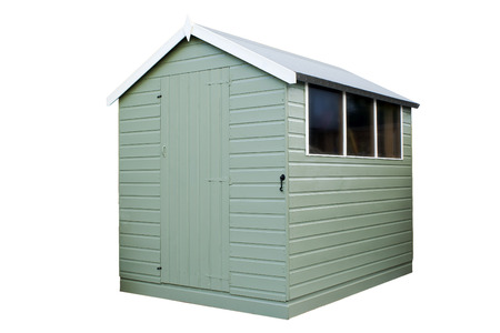 Wooden garden shed painted in green on an isolated white background with a clipping path