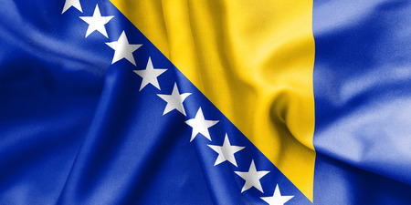 creased: Bosnia and Herzegovina flag texture creased and crumpled up with light and shadows