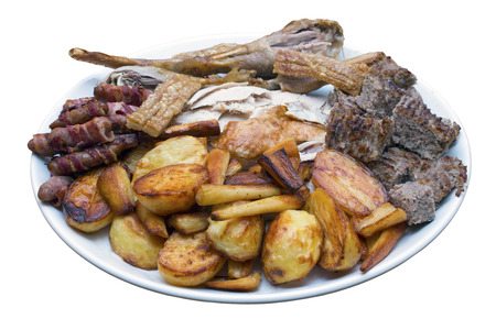 parsnips: Roast dinner serving platter with turkey, roast potatoes, parsnips, sausages, stuffing and crackling on an isolated white background with a clipping path Stock Photo