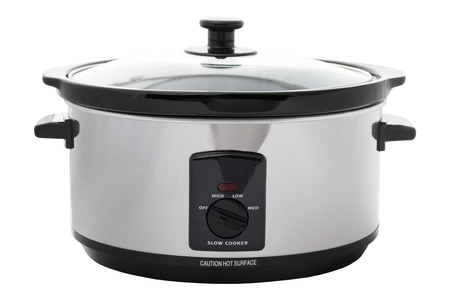 slow cooker: Slow cooker on an isolated white background with a clipping path Stock Photo