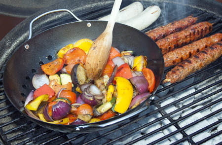 kebob: Barbecue vegetables and kebabs grilling on a grid of smoking hot coals