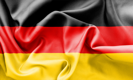 creased: Germany flag texture creased and crumpled up with light and shadows Stock Photo