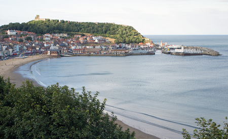 north yorkshire: Scarborough, North Yorkshire, UK - Aug 8, 2016: View of South bay Scarborough showing the beach, castle and harbour