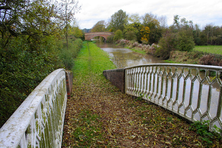 Rural canal tow path on an overcast Autumn day in Warwickshire United Kingdom Stock Photo