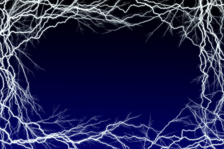 Lighting sparks frame with a graduated blue to black background with copy space for additional message Stock Photo