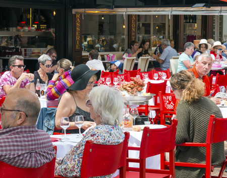 Saint Malo, Brittany, France - July 4, 2017: People dining outdoors at restaurants in Place Chateaubriand Saint Malo Editorial