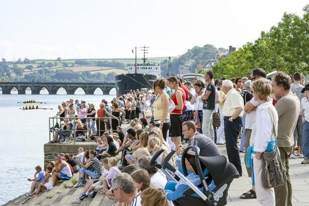 Bideford, Devon, UK - August 26, 2007: Crowds of people lined up along the river Torridge to watch regatta rowing races in Bideford