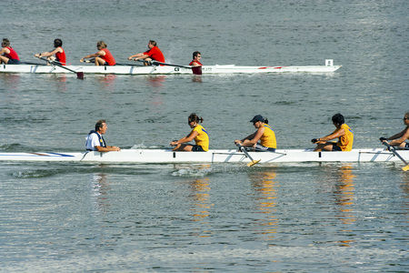 Bideford, Devon, UK - August 26, 2007: Teams of rowers in boat race at the Bideford regatta on the river Torridge