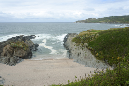 Sheltered beach in Woolacombe on a cloudy summer day