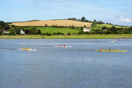 Bideford, Devon, UK - August 26, 2007: View across the river Torridge in Bideford with rowing boats on a warm summer day