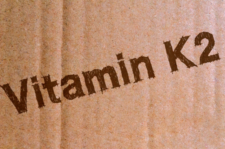 Vitamin K2 - carton, cardboard with brown letters Stock Photo