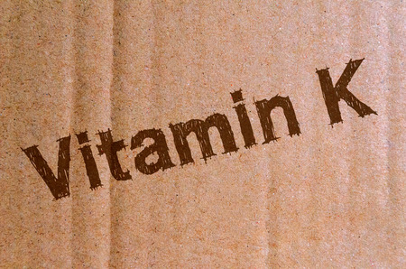 Vitamin K - carton, cardboard with brown letters