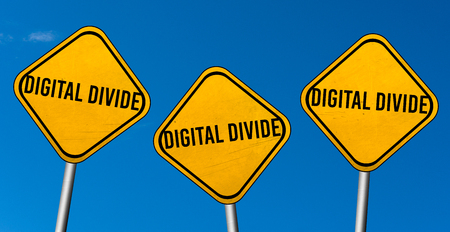 Digital divide - yellow signs with blue sky
