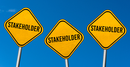 Stakeholder - yellow signs with blue sky