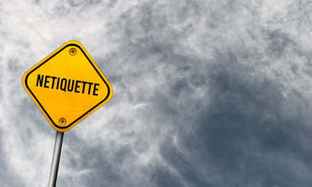 Netiquette - yellow sign with cloudy sky