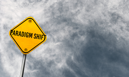 Paradigm shift - yellow sign with cloudy sky Stock Photo