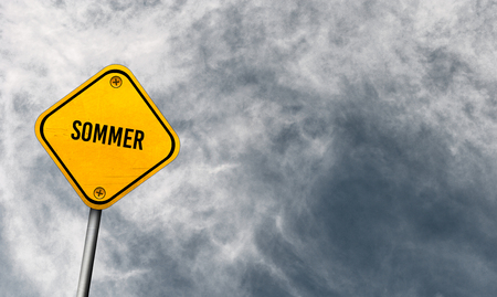 Sommer - yellow sign with cloudy sky