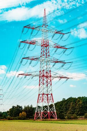 A red white pylon during summertime on a low angle at daylight, Darmstadt, germany Imagens - 131794628