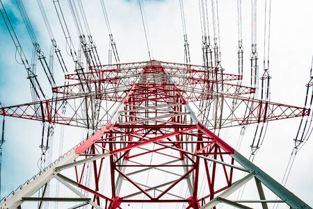 A red white pylon during summertime on a low angle at daylight, Darmstadt, germany