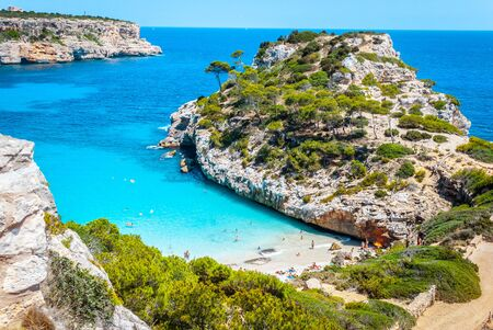 Calo des Moro beach, Mallorca, spain on a sunny day with people on the beach
