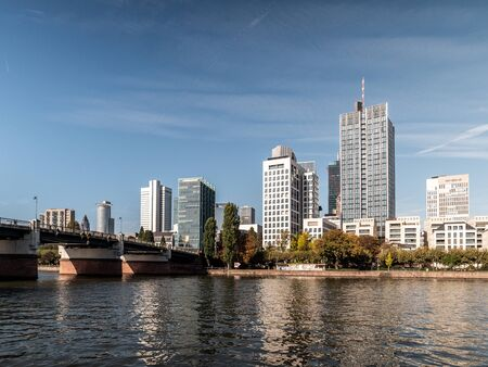 Tthe Frankfurt Skyline with Untermainbruecke at daylight with clear sky, hessen, germany