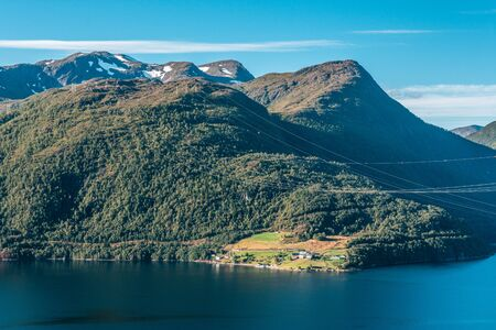 Fjord with mountains in Norway during summertime