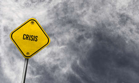 Yellow crisis sign with cloudy background Stock fotó