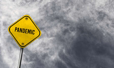 Yellow pandemic sign with cloudy background Stock fotó
