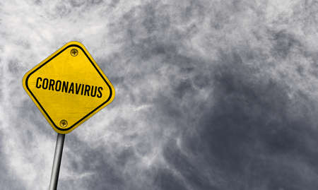 Yellow coronavirus sign with cloudy background Stock fotó