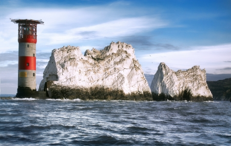 Lighthouse on a rock, The Needles, Isle Of Wight, view from the sea  Zdjęcie Seryjne