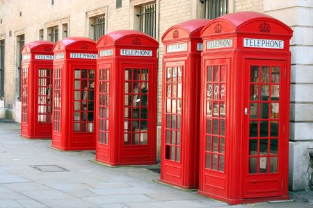 A photography of five old red phone boxes in London photo