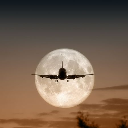 panning: A photography of a jet air plane in the moon Stock Photo