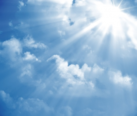 A photography of a blue sky with sun rays